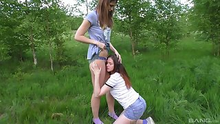 Nature loving lesbian teens play with toys in their pussies outdoors